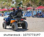security guards on a beach. | Shutterstock . vector #1075773197