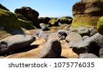 rocky coast at low tide  the... | Shutterstock . vector #1075776035