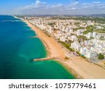 wide sandy beach in touristic... | Shutterstock . vector #1075779461