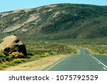 winding road with mountains... | Shutterstock . vector #1075792529