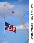 Small photo of A Manitowoc boom crane owned by Southwest Industrial Rigging in Phoenix, Arizona displays Old Glory. Shot on March 15, 2018.