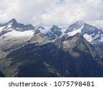 alpine mountains range... | Shutterstock . vector #1075798481