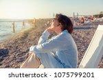 beautiful elderly woman sitting ... | Shutterstock . vector #1075799201