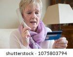 Senior Woman Giving Credit Card ...