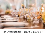 served dinner table in a... | Shutterstock . vector #1075811717