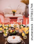 easter table set in yellow... | Shutterstock . vector #1075811744
