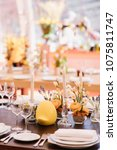 easter table set in yellow... | Shutterstock . vector #1075811747