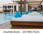 Stock photo details of saadiyat beach club abu dhabi beds near the pool vacation concept 1075817621
