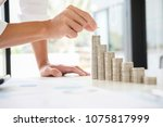 rows of coins for finance and... | Shutterstock . vector #1075817999