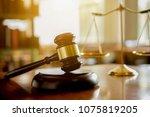 judge gavel with justice ... | Shutterstock . vector #1075819205