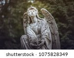 religious statue of an angel... | Shutterstock . vector #1075828349