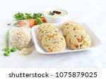 oats idli or cake  a healthy... | Shutterstock . vector #1075879025