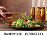 vegetable salad with olive oil... | Shutterstock . vector #1075889651