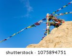 Pillar of colorful flags with vivid color use as tailsman for safety travel in tibetan on mountain hill, Leh - India