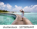 attractive woman walks on a... | Shutterstock . vector #1075896449