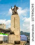 Small photo of Seoul/South Korea - September 26, 2014:In central Seoul, South Korea stands a statue of Admiral Yi Sun-Sin. Here, on a cloudy afternnon.