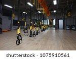 trx straps in modern gym | Shutterstock . vector #1075910561