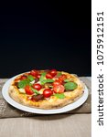 tasty pizza on a the table | Shutterstock . vector #1075912151