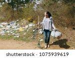 young upset shocked woman... | Shutterstock . vector #1075939619