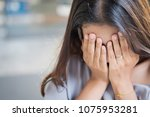 crying girl doing face palm ... | Shutterstock . vector #1075953281
