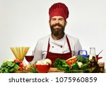 cook with cheerful face in... | Shutterstock . vector #1075960859