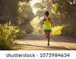 young fitness woman runner... | Shutterstock . vector #1075984634