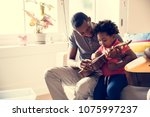 african father teaching son how ... | Shutterstock . vector #1075997237