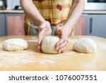 baker hands preparing... | Shutterstock . vector #1076007551