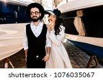 fashionable wedding couple near ...   Shutterstock . vector #1076035067