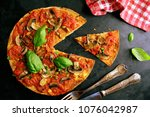 delicious vegan pizza | Shutterstock . vector #1076042987