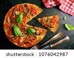 delicious vegan pizza | Shutterstock . vector #1076042987