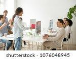 female colleague making...   Shutterstock . vector #1076048945