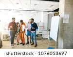 mixed race students having fun. ... | Shutterstock . vector #1076053697