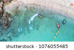 people are playing jet ski at... | Shutterstock . vector #1076055485