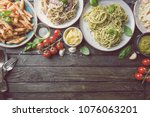 several plates of pasta with... | Shutterstock . vector #1076063201