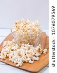 popcorn in galss bowl on wooden ... | Shutterstock . vector #1076079569