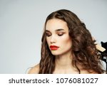 beautiful brunette with closed ... | Shutterstock . vector #1076081027
