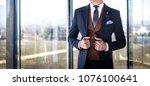 man in custom tailored suit... | Shutterstock . vector #1076100641