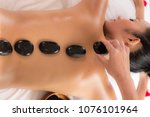 hot stones and massage in spa... | Shutterstock . vector #1076101964