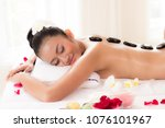 hot stones and massage in spa... | Shutterstock . vector #1076101967
