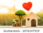 house model and red heart for... | Shutterstock . vector #1076147519