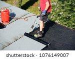 waterproofing flat roof with... | Shutterstock . vector #1076149007