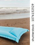Small photo of Beach concept with air mattress