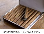 hand rolled cuban cigars in... | Shutterstock . vector #1076154449