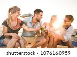 group of happy millenial... | Shutterstock . vector #1076160959