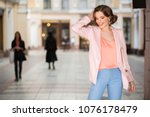attractive woman dressed in... | Shutterstock . vector #1076178479
