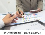 businessmen hand are invstment... | Shutterstock . vector #1076183924