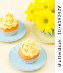 cupcakes with yellow cream... | Shutterstock . vector #1076192429