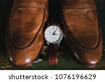 the wrist watch is next to the... | Shutterstock . vector #1076196629