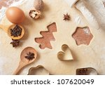 Christmas baking background with dough, spices and cookie cutters - stock photo
